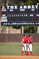Colin Rosenbaum (10) and Ryan Allen (1) of the Belmont Abbey Crusaders stand for the National Anthem prior to the game against the Shippensburg Raiders at Abbey Yard on February 8, 2015 in Belmont, North Carolina.  The Raiders defeated the Crusaders 14-0.  (Brian Westerholt/Four Seam Images)