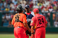 15 February 2009: Left pitcher Aroldis Chapman of the Orientales talks to Catcher Ariel Pestano and pitching coach Elosegui  during a training game of Cuba Baseball Team for the World Baseball Classic 2009. The national team is pitted against itself, divided in two teams called the Occidentales and the Orientales. The Orientales win 12-8, at the Latinoamericano stadium, in la Habana, Cuba.