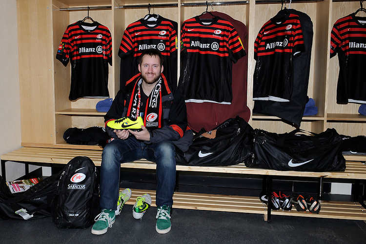20130303 Copyright onEdition 2013©.Free for editorial use image, please credit: onEdition..An Allianz competition winner holds one of Schalk Brits' new boots in the players' dressing room before the Premiership Rugby match between Saracens and London Welsh at Allianz Park on Sunday 3rd March 2013 (Photo by Rob Munro)..For press contacts contact: Sam Feasey at brandRapport on M: +44 (0)7717 757114 E: SFeasey@brand-rapport.com..If you require a higher resolution image or you have any other onEdition photographic enquiries, please contact onEdition on 0845 900 2 900 or email info@onEdition.com.This image is copyright onEdition 2013©..This image has been supplied by onEdition and must be credited onEdition. The author is asserting his full Moral rights in relation to the publication of this image. Rights for onward transmission of any image or file is not granted or implied. Changing or deleting Copyright information is illegal as specified in the Copyright, Design and Patents Act 1988. If you are in any way unsure of your right to publish this image please contact onEdition on 0845 900 2 900 or email info@onEdition.com