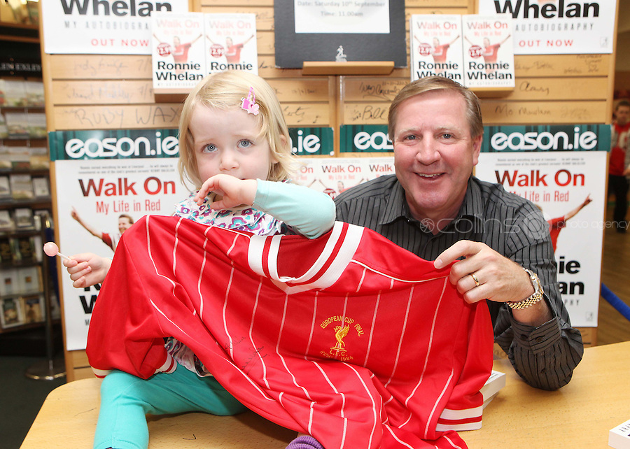 ***NO FEE PIC ***.10/09/2011.Eason Ireland's leading retailer of books , stationery, magazines & lots more hosted a book signing by former Liverpool & Irish international soccer player Ronnie Whelan..Pictured at Eason O' Connell street, Dublin is Ronnie Whelan &  Hannah Culligan (2) From Shannon Co. Clare signing copies of his new autobiography WALK ON for fans..Follow Eason on twitter- @easons..Photo: Collins