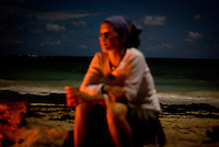 A traveller enjoys a bon fire at night on Little Corn Island off the Caribbean coast of Nicaragua in April, 2009.