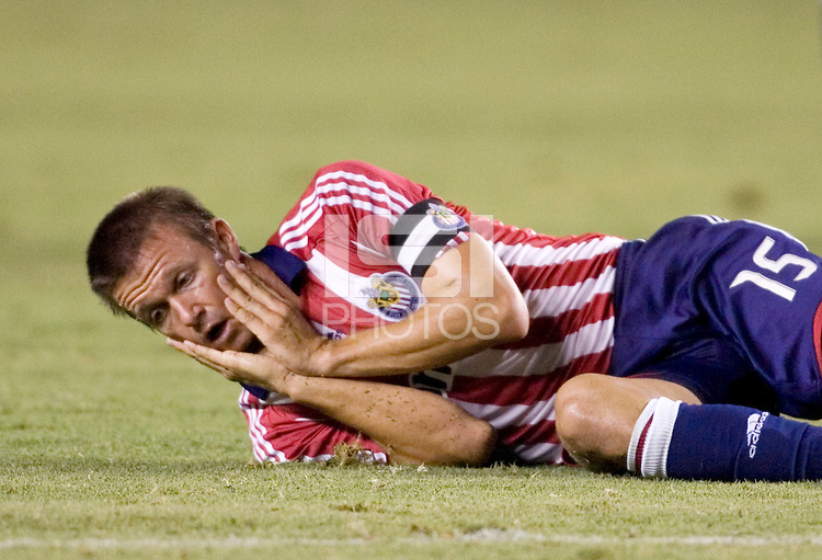 Chivas USA midfielder Jesse Marsch (15) lies on the ground in pain after being elbowed in the jaw during the SuperClasico MLS game.  The LA Galaxy and Chivas USA played to a 2-2 draw at Home Depot Center stadium in Carson, California on Thursday, August 14, 2008.