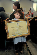 March 1982, Lebanon, Martyrs' Day, a little girl holding her father's death certificate who was killed during an israelian airstrike.