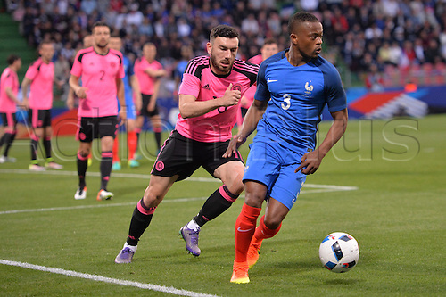 04.06.2016. Stade Saint Symphorien, Metz, France. International football freindly,France versus Scotland.  PATRICE EVRA chased down by Robert Snodgrass