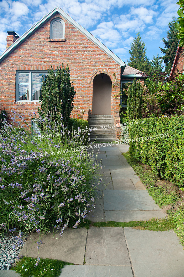 Flagstone walkway leading to the front door and patio area of this Seattle home.
