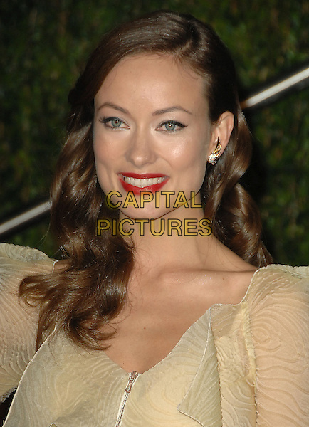 OLIVIA WILDE .The 2010 Vanity Fair Oscar Party held at The Sunset Tower Hotel in West Hollywood, California, USA..March 7th, 2010.oscars headshot portrait beige red lipstick .CAP/RKE/DVS.©DVS/RockinExposures/Capital Pictures.