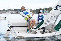 Skipper Sean Beaulieu,'18, and Crew Jen Ryan '19, work together to tack as the Salve Regina Sailing Team practices in the Newport Harbor.