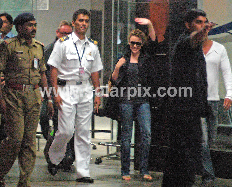 **ALL ROUND PICTURES FROM SOLARPIX.COM**.**WORLDWIDE SYNDICATION RIGHTS**.Kylie Minogue is poised to make her Bollywood debut with a song-and-dance routine in a new movie with one of India's most popular action stars. Kylie Minogue arrived at midnight at Chatrapati Shivaji International Air Port, Andheri in Mumbai, India. 26 February 2009. ..This pic: Kylie Minogue..JOB REF: 9574 SJA        DATE: 26_02_2009.**MUST CREDIT SOLARPIX.COM OR DOUBLE FEE WILL BE CHARGED**.**MUST NOTIFY SOLARPIX OF ONLINE USAGE**.**CALL US ON: +34 952 811 768 or LOW RATE FROM UK 0844 617 7637**