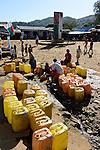 MADAGASCAR, Vohilava, water supply, yellow Jerry can / MADAGASKAR Mananjary, Vohilava, Marktplatz, Wasserversorgung, gelbe Plastik Kannister