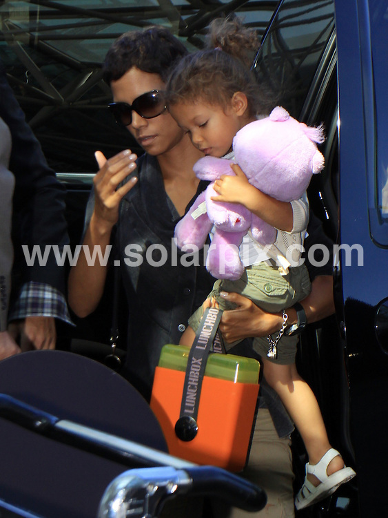 **ALL ROUND PICTURES FROM SOLARPIX.COM**.**SYNDICATION RIGHTS FOR UK, AUSTRALIA, DENMARK, PORTUGAL, S. AFRICA, SPAIN & DUBAI (U.A.E) & ASIA (EXCLUDING JAPAN) ONLY**.Halle Berry, Gabriel Aubry and daughter Nahla Ariela Aubry Depart From LAX For A Month Long Trip To South Africa, LA, USA, 24 July 2010.This pic: Halle Berry, Gabriel Aubry and Nahla Ariela Aubry.JOB REF: 11755   PHZ  candids   DATE: 24_07_2010.**MUST CREDIT SOLARPIX.COM OR DOUBLE FEE WILL BE CHARGED**.**MUST NOTIFY SOLARPIX OF ONLINE USAGE**.**CALL US ON: +34 952 811 768 or LOW RATE FROM UK 0844 617 7637**