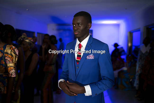 KINSHASA, DRC - JULY 25: A model waits backstage walking for the South Africa based label Csquared a before a show at Kinshasa Fashion Week on July 25, 2015, at the boxing gym at Shark club in Kinshasa, DRC. Local and invited foreign-based designers showed their collections during the 2015 edition of Kinshasa Fashion week. (Photo by Per-Anders Pettersson)