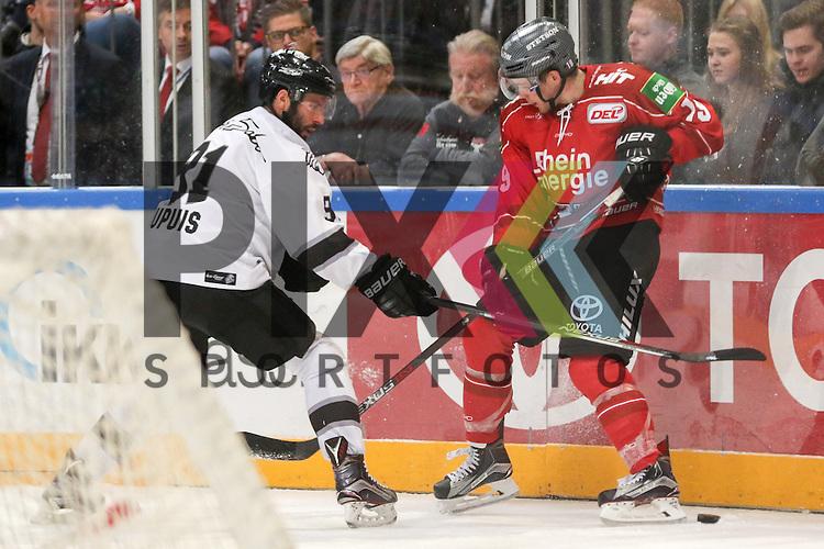 Nuernbergs Philippe Dupuis (Nr.91) im Zweikampf mit Koelns Nick Latta (Nr.19)  beim Spiel in der DEL, Koelner Haie (dunkel) - Nuernberg Ice Tigers (weiss).<br /> <br /> Foto &copy; PIX-Sportfotos *** Foto ist honorarpflichtig! *** Auf Anfrage in hoeherer Qualitaet/Aufloesung. Belegexemplar erbeten. Veroeffentlichung ausschliesslich fuer journalistisch-publizistische Zwecke. For editorial use only.