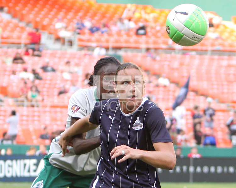 Abby Wambach #20 of the Washington Freedom goes for the ball with Tina Ellertson #8 during a WPS match against St. Louis Athletica on May 1 2010, at RFK Stadium, in Washington D.C.Freedom won 3-1.