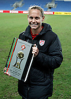 USA's Christie Rampone holds  the trophy after their Algarve Women's Cup soccer match final against Germany at Algarve stadium in Faro, March 13, 2013.  .