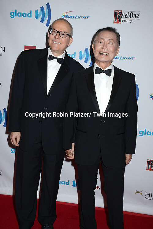 George Takei and husband Brad Altman attends the 25th Annual GLAAD Media Awards at the Waldorf Astoria Hotel in New York City, NY on May 3, 2014.