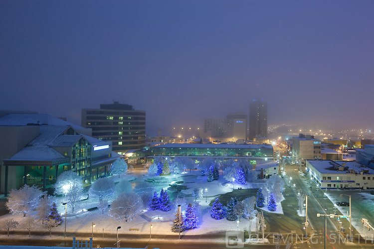 Photo of Anchorage's Town Square, decorated with Christmas lights,  twilight, winter, Southcentral Alaska, USA.