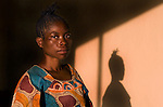 Kasindi  Wabulasa, 36 yrs old- from near Bukavu, Eastern Congo.  She was raped twice in separate attacks in February and March 2007.  By different groups of armed men.  The first time she was raped, her husband was forced to watch as five men gang raped her when they were finished they shot the husband in the head in front of her. She said 'I can not be shamed everybody knows I've been raped'.  <br />