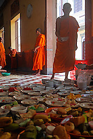 Offering during a festival in a Buddhist Temple and Monastery, Phnom Penh, Cambodia.