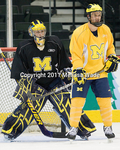 Bryan Hogan (Michigan - 35), Luke Glendening (Michigan - 23) - The University of Michigan Wolverines practiced on Friday morning, April 8, 2011, during the 2011 Frozen Four at the Xcel Energy Center in St. Paul, Minnesota.