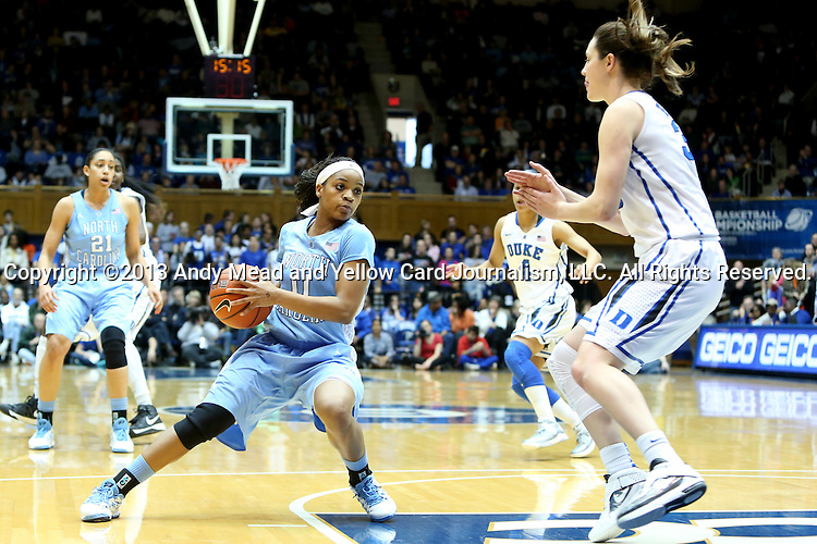 03 March 2013: North Carolina's Brittany Rountree (11) and Duke's Haley Peters (right). The Duke University Blue Devils played the University of North Carolina Tar Heels at Cameron Indoor Stadium in Durham, North Carolina in a 2012-2013 NCAA Division I and Atlantic Coast Conference women's college basketball game. Duke won the game 65-58.