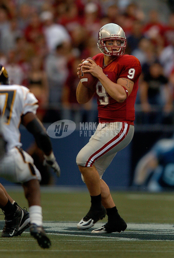Sep 17, 2005; Seattle, WA, USA; Washington State Cougars quarterback Josh Swooger #9 drops back to pass against the Grambling State Tigers during the second quarter at Qwest Field. Mandatory Credit: Photo By Mark J. Rebilas
