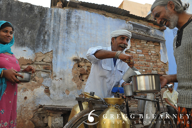 Ramratan makes one of his door-to-door deliveries to a family he's brought milk to for 40 years.