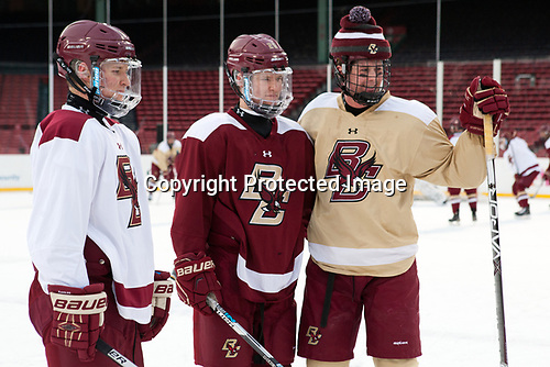 Jesper Mattila (BC - 8), Julius Mattila (BC - 26) and Zach Walker (BC - 14) pose for the Mattilas' father. - The Boston College Eagles practiced at Fenway on Friday, January 6, 2017, in Boston, Massachusetts.