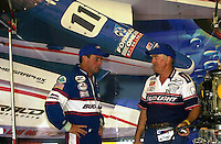Mike Seebold (L) talks with his father Bill Seebold in front of the Bud Light/Team Seebold transporter.