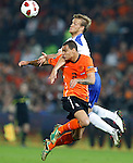 Netherlands' Gregory van der Wiel (bottom) fights for the ball with Finland's Mika Vayrynen (to)during their Euro 2012 qualifying soccer match in Rotterdam September 7, 2010. REUTERS/Michael Kooren (NETHERLANDS)