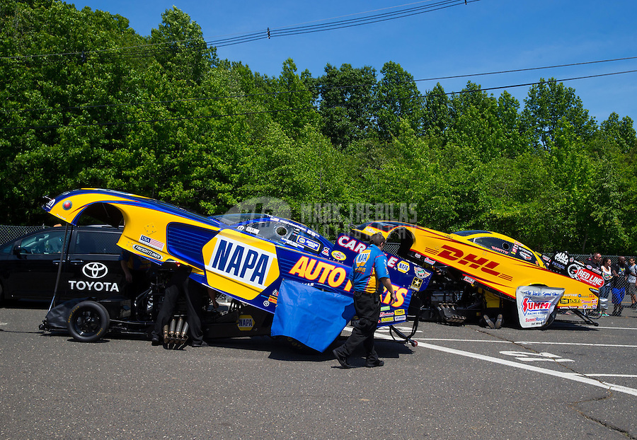 Jun 7, 2015; Englishtown, NJ, USA; The car of NHRA funny car driver Ron Capps (left) sits in the staging lanes alongside Del Worsham during the Summernationals at Old Bridge Township Raceway Park. Mandatory Credit: Mark J. Rebilas-