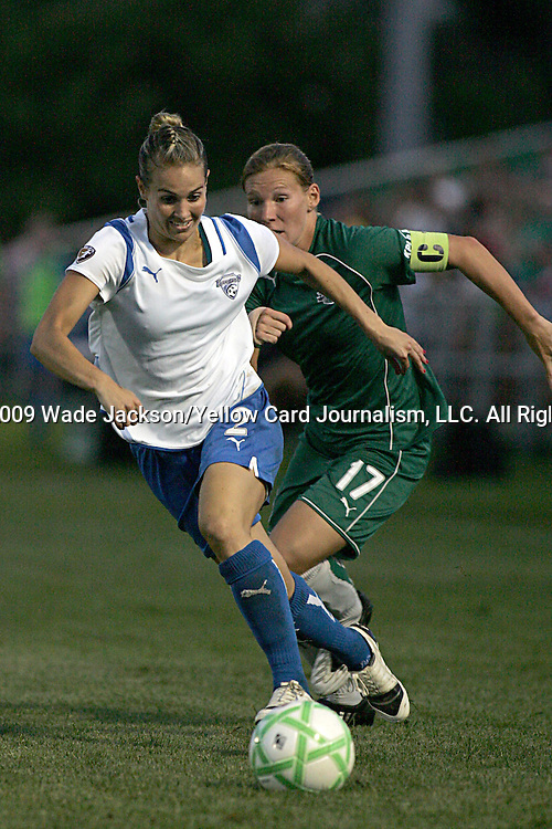 01 Aug 2009: Heather Mitts (2) of the Breakers moves the ball past Lori Chalupny (17) of Saint Louis Athletica.  Saint Louis Athletica defeated the visiting Boston Breakers 1-0 in a regular season Women's Professional Soccer game at Anheuser-Busch Soccer Park, in Fenton, MO.