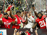 Ohio State Buckeyes wide receiver Terry McLaurin and head coach Urban Meyer hoist the Amos Alonzo Stagg Championship Trophy between running back Mike Weber Jr., left, and wide receiver Parris Campbell Jr. following their 45-24 win over the Northwestern Wildcats in the Big Ten Championship at Lucas Oil Stadium in Indianapolis on Dec. 1, 2018. [Adam Cairns/Dispatch]
