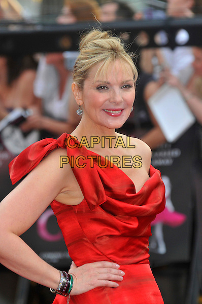 "KIM CATTRALL .Red Carpet Arrivals at the ""Sex And The City"" Movie World Premiere, Odeon Leicester Square, London, England, UK,.May 12th 2008..half length Vivienne Westwood red dress draped hand on hip off the shoulder.CAP/PL.©Phil Loftus/Capital Pictures"