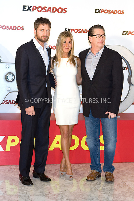 WWW.ACEPIXS.COM . . . . .  ..... . . . . US SALES ONLY . . . . .....March 30 2010, Madrid....Actors Gerald Butler  and Jennifer Aniston and director Andy Tennant at a photocall for 'Exposados' (The Bounty Hunter) at the Villamagna Hotel on March 30, 2010 in Madrid, Spain.......Please byline: FD-ACE PICTURES... . . . .  ....Ace Pictures, Inc:  ..tel: (212) 243 8787 or (646) 769 0430..e-mail: info@acepixs.com..web: http://www.acepixs.com