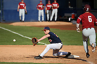Jake Pavletich #23 of the Cal State Fullerton Titans takes a throw as Kyle Stowers #6 of the Stanford Cardinal runs to first base at Goodwin Field on February 19, 2017 in Fullerton, California. Stanford defeated Cal State Fullerton, 8-7. (Larry Goren/Four Seam Images)