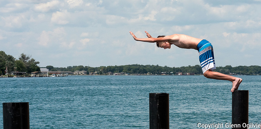 Diving for treasure at the Corunna Stage Island ferry dock is a great pastime for teenagers on summer holidays. Logan Forbes, 14, of Corunna