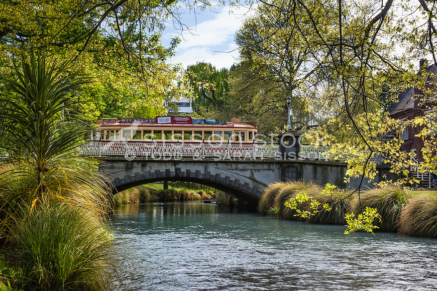 Historic Christchurch tram crossing a bridge over the Avon River, Canterbury, New Zealand (pre February 2011 earthquake) - stock photo, canvas, fine art print