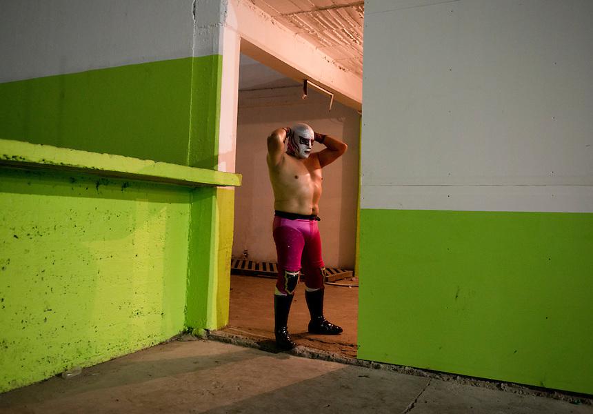 Luchadores wait for their turn to go to the ring. Lucha Libre in Santa Maria Tulpetlac, Ecatepec, Estado de Mexico.