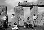 Stonehenge, Wiltshire. 1979 <br /> Tourists, revellers and police attend the three-day free festival.