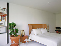 The master bedroom is furnished with a suite by Autoban matched with a Charles & Ray Eames leather armchair