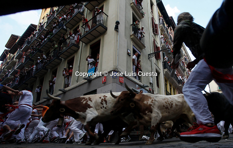 Sixth day of bull run in Estafeta street, Pamplona, northern of Spain.  San Fermin festival is worldwide known because the daily running bulls.