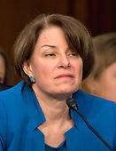 United States Senator Amy Klobuchar (Democrat of Minnesota) listens as Judge Neil Gorsuch testifies before the committee on his nomination as Associate Justice of the US Supreme Court to replace the late Justice Antonin Scalia on Capitol Hill in Washington, DC on Tuesday, March 21, 2017.<br /> Credit: Ron Sachs / CNP