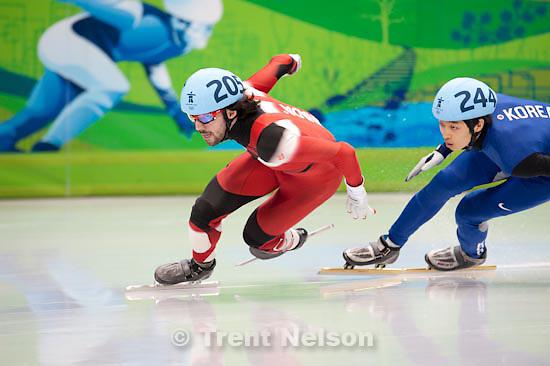 Trent Nelson  |  The Salt Lake Tribune.Men's 500m Quarterfinals, Short Track Speed Skating at the Pacific Coliseum Vancouver, XXI Olympic Winter Games, Friday, February 26, 2010. Charles Hamelin (Canada), Sung Si-Bak (Korea)