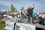 The Rev. Jorge Rodriguez (right), a United Methodist pastor, leads participants in song at a rally outside a federal detention center in Sheridan, Oregon. Participants protested the Trump administration's policy of separating parents from their children at the U.S.-Mexico border.
