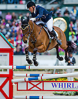 PARK TRADER, ridden by Bruce (Buck) Davidson Jr. (USA), competes during Stadium Jumping at the Rolex 3-Day Event at the Kentucky Horse Park in Lexington, Kentucky on April 28, 2013.