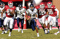 Florida International University Golden Panthers versus the University of Arkansas Razorbacks at Donald W. Reynolds Razorback Stadium, Fayetteville, Arkansas on Saturday, October 27, 2007.  The Razorbacks defeated the Golden Panthers, 58-10...FIU sophomore quarterback Wayne Younger (14) (Cocoa, Fla.) breaks away from the Arkansas defense on a thirty-five yard run in the second quarter.