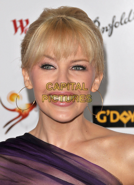 KYLIE MINOGUE.Attends The Annual G'Day USA Australia.com Black Tie Gala held at Hollywood & Highland Ballroom in Hollywood, California, USA, January 19th 2008.                                                                                       portrait headshot fringe gold hoop earrings.CAP/DVS.©Debbie VanStory/Capital Pictures