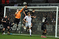 Pictured: Keiren Westwood goalkeeper for Coventry City (in orange) punches the ball away with the support of team mate Leon McKenzie (top) and other players, preventing Garry Monk of Swansea (in white) to score. <br />