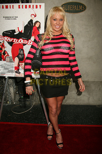"MARY CAREY.""Kickin' It Old Skool"" Los Angeles Premiere Party at the Music Box Theatre, Hollywood, California, USA..April 25th, 2007.full length black pink skirt top sweater jumper striped stripes bag purse bracelets bangles see through thru .CAP/ADM/BP.©Byron Purvis/AdMedia/Capital Pictures"