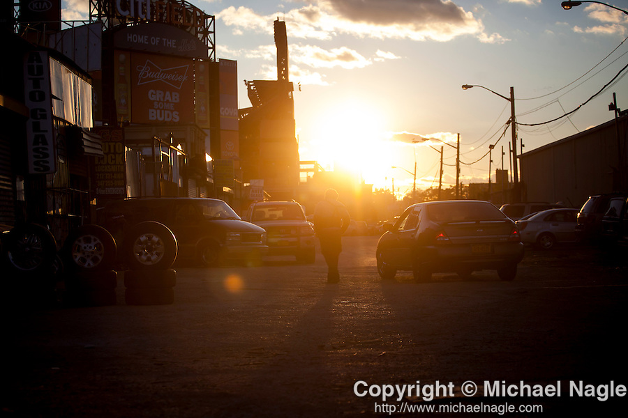 QUEENS, NY -- OCTOBER 25, 2013:  A worker talks to a passing car in Willets Point on October 25, 2013 in Queens, NY.  PHOTOGRAPH  BY MICHAEL NAGLE FOR THE NEW YORK TIMES
